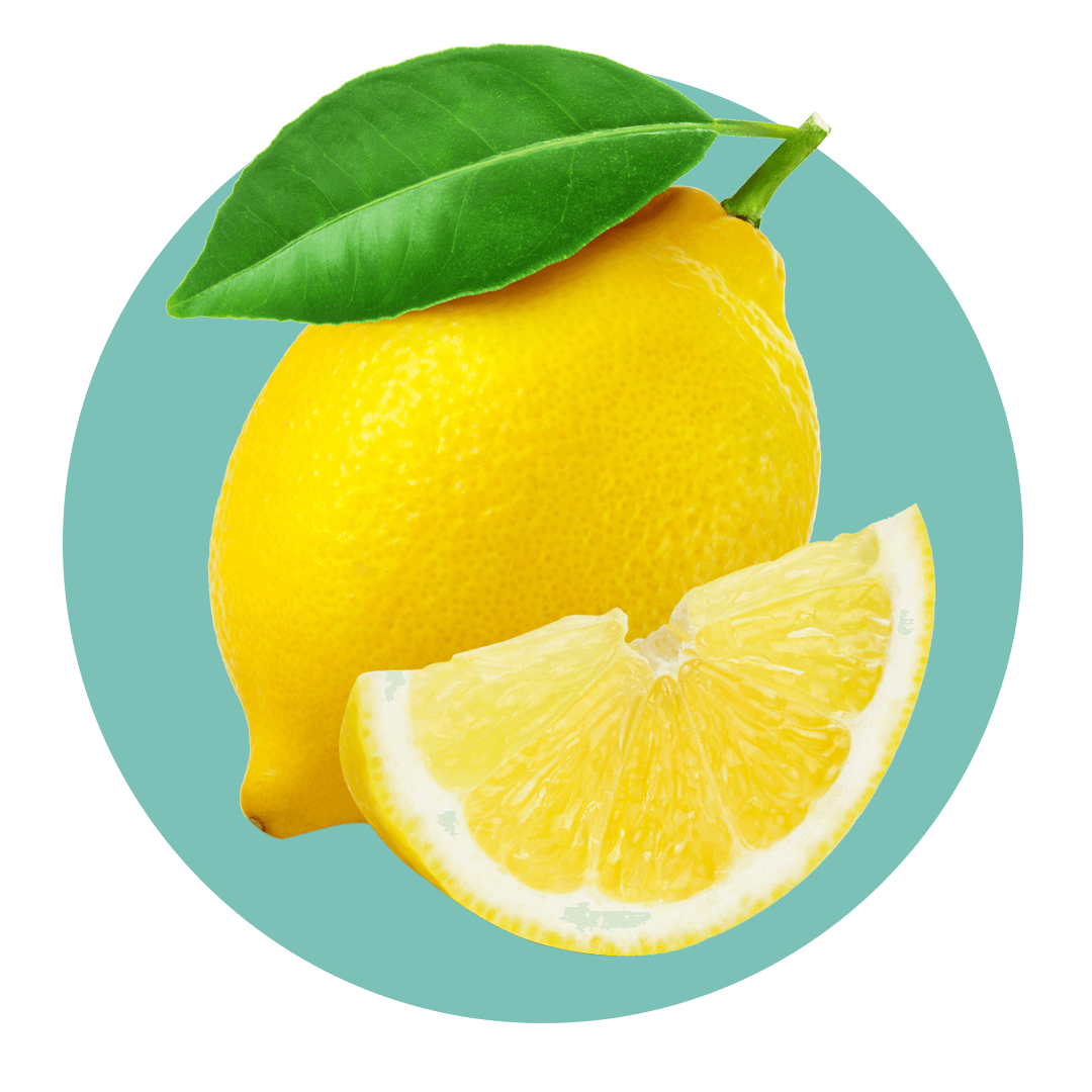 Lemon slice next to lemon with green leaf