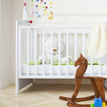 Children's cot and wooden rocking horse