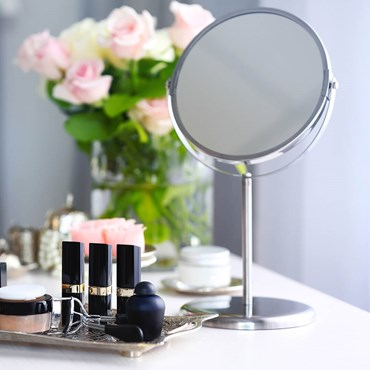 Mirror and makeup on dressing table