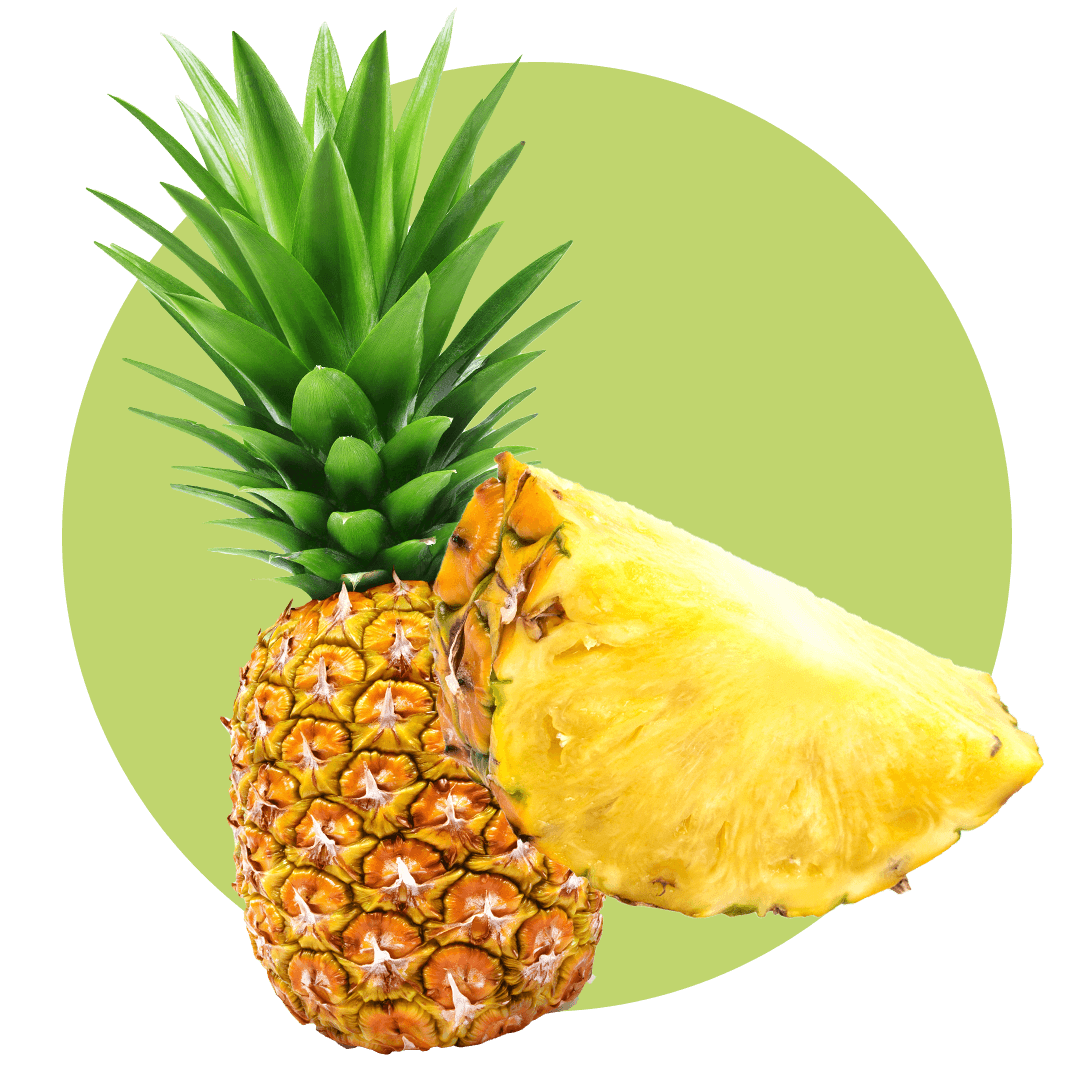 Cut pineapple next to a whole pineapple