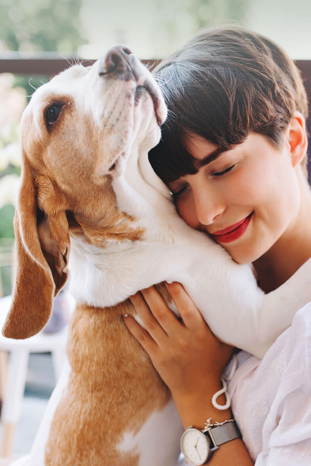 Portrait of woman hugging her dog
