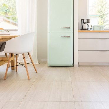 Clean kitchen floor with pale green fridge