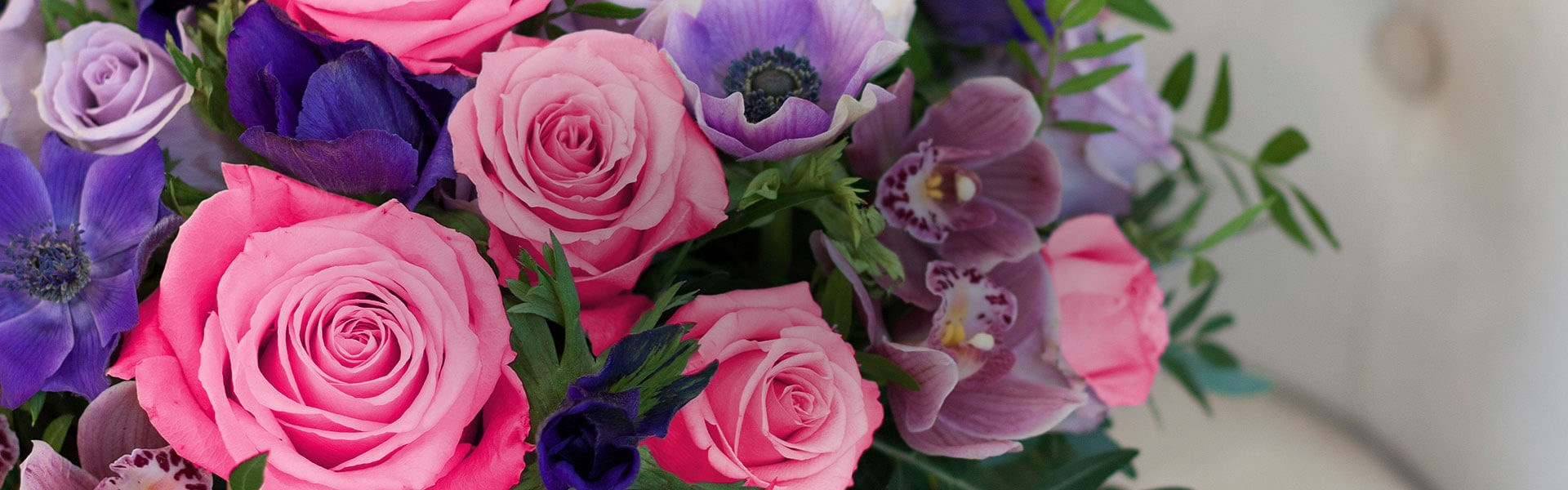 Wide angle of a bouquet of blue, pink and purple flowers