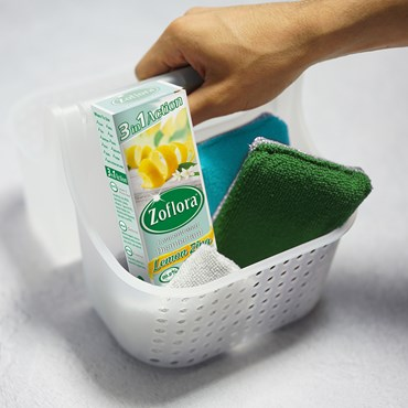 Zoflora in cleaning tray next to sponge