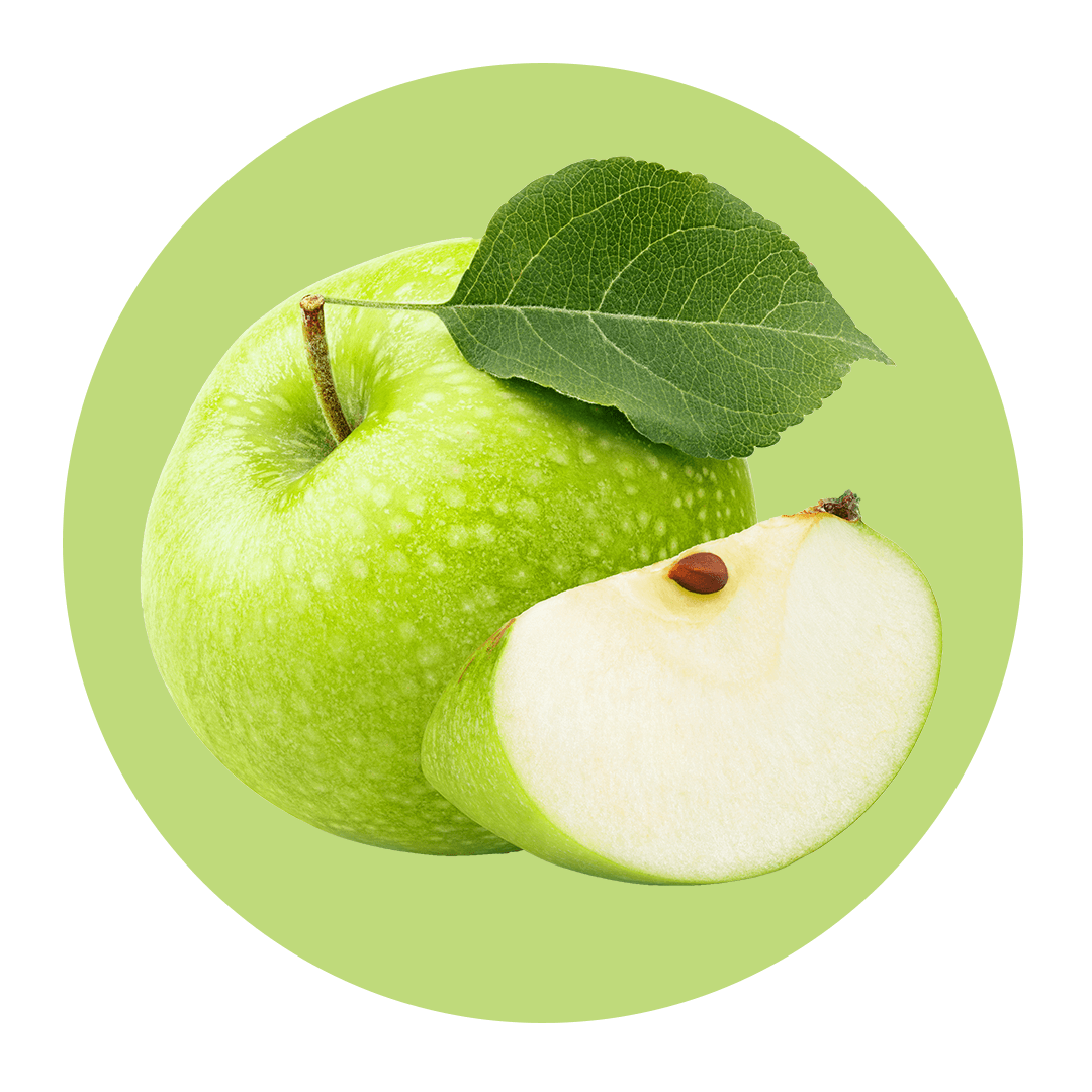 Sliced apple next to whole green apple