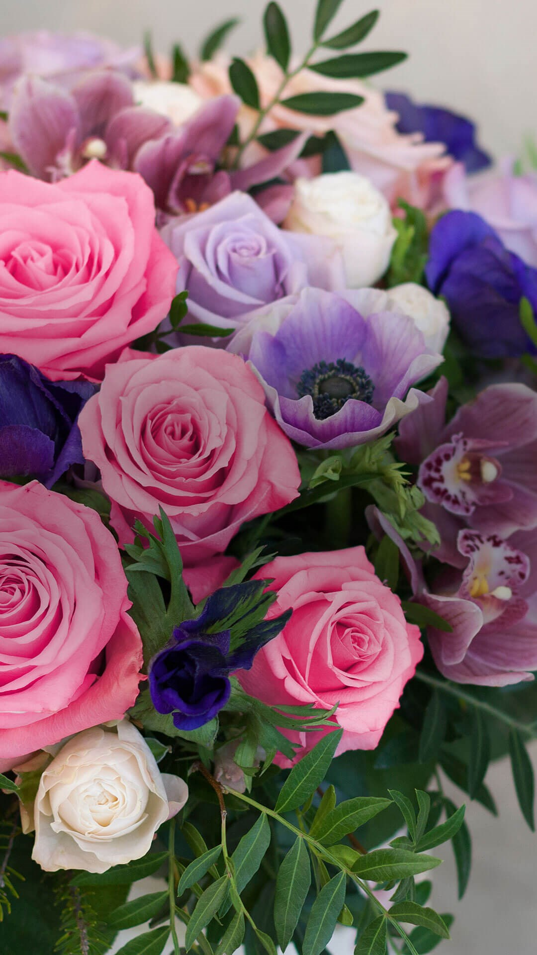 Portrait of a bouquet of blue, pink and purple flowers