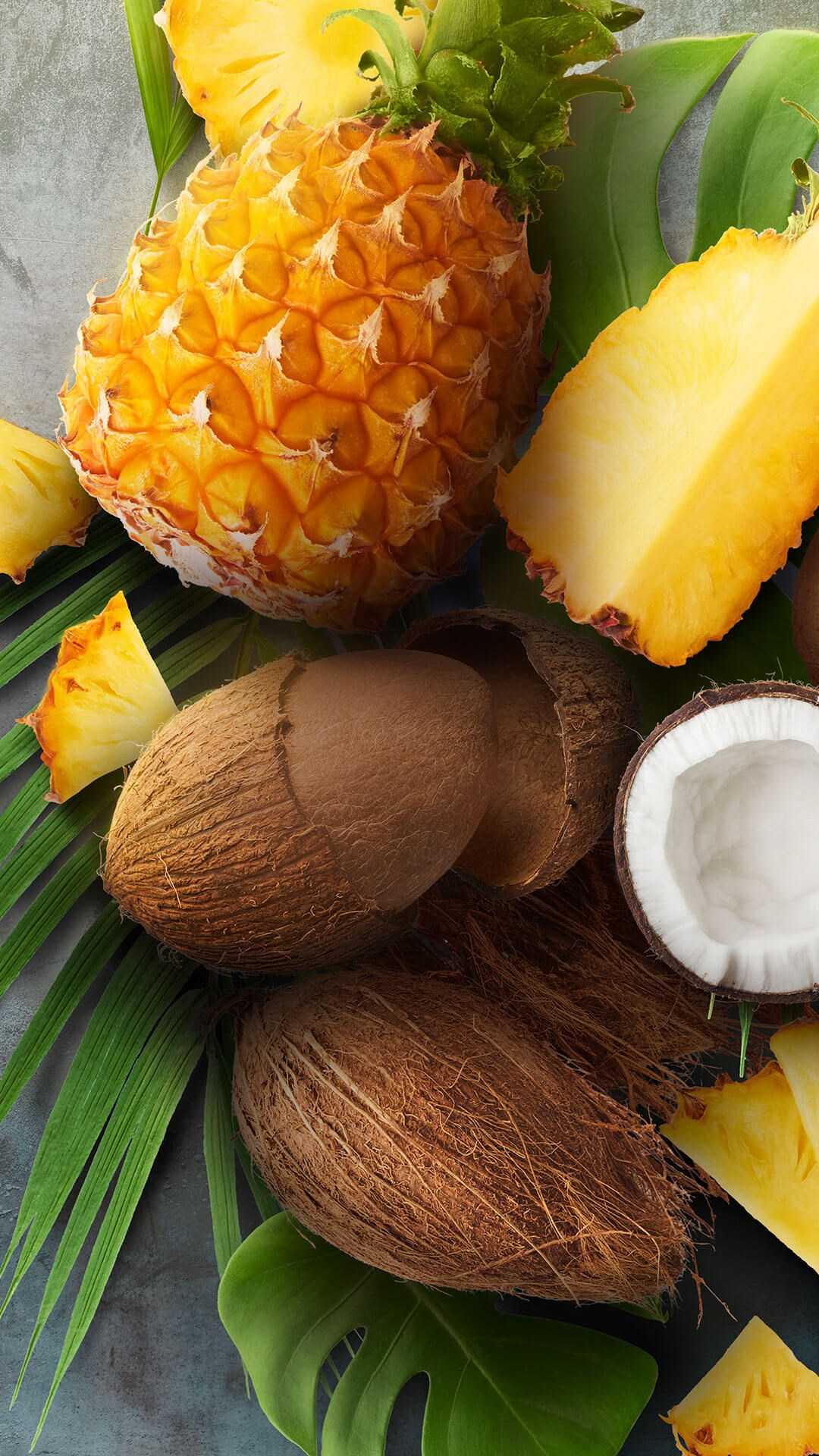 Portrait of tropical fruits - Cut pineapples and coconuts